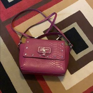 Authentic burgundy Guess purse